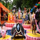Models being decorated on a vehicle in front of the ISKCON temple, Kolkata